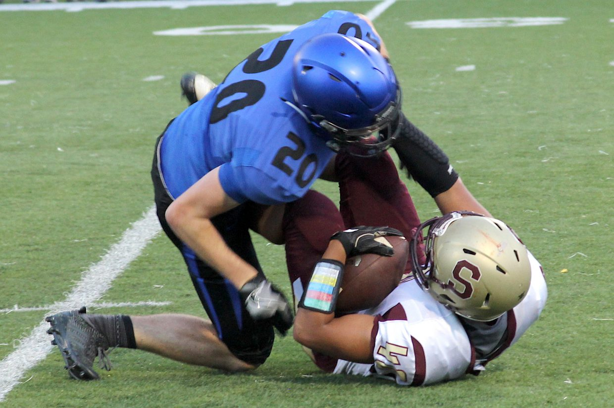 South Tahoe senior linebacker Caleb Moretti smashes a Sparks ball carrier Friday night. Moretti made two interceptions and returned them both for touchdowns.
