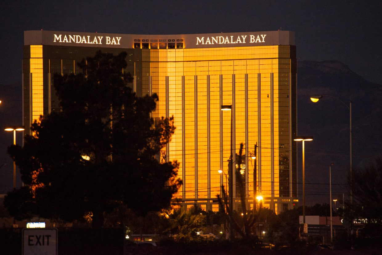 The rising sun is reflected in the Mandalay Bay Casino as seen from the Thomas & Mack center where people took refuge, following a mass shooting in which dozens were killed at the Route 91 music festival on the Las Vegas Strip, Monday, Oct. 2, 2017.