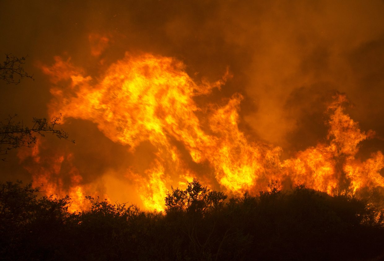 Flames from a wildfire burn Monday, Oct. 9, 2017, in Napa, Calif. The fire is one of several burning across Northern California's wine country.