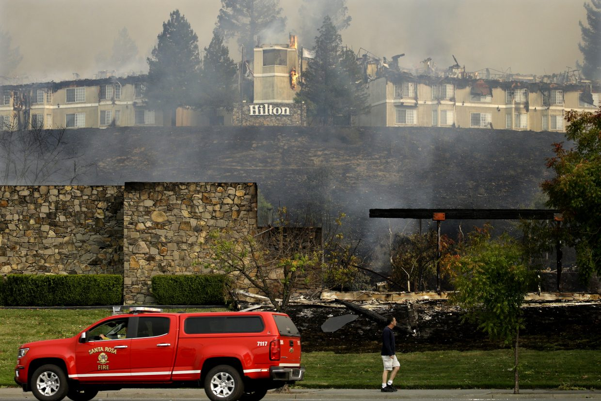 A fire burns at a Hilton hotel on Monday, Oct. 9, 2017, in Santa Rosa, Calif. Wildfires whipped by powerful winds swept through Northern California sending residents on a headlong flight to safety through smoke and flames as homes burned.