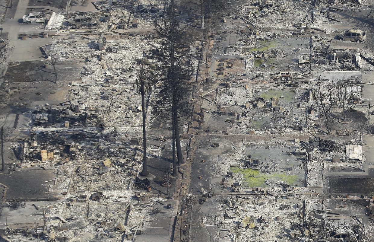 Homes destroyed from fires are seen from an aerial view in Santa Rosa, Calif., Wednesday, Oct. 11, 2017.