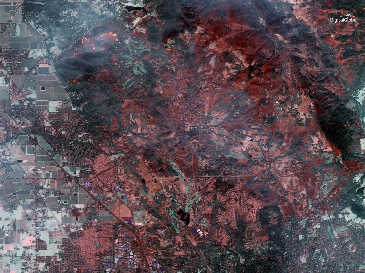 This Tuesday, Oct. 10, 2017, satellite image using shortwave infrared (SWIR) provided by DigitalGlobe shows damage from the wildfire in Santa Rosa, Calif. SWIR imagery allows for the ability to see though smoke to identify active fires, top left. Wildfires whipped by powerful winds swept through Northern California sending residents on a headlong flight to safety through smoke and flames as homes burned.