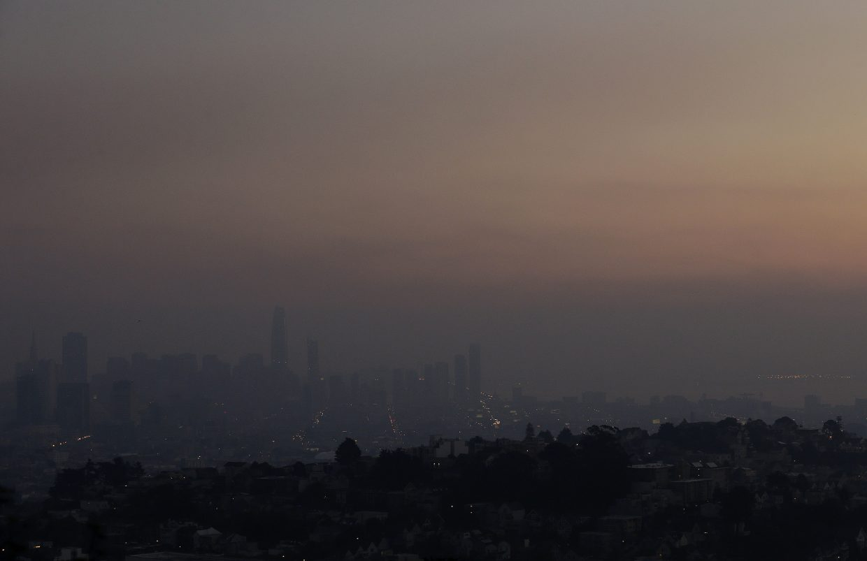 Smoke from regional wildfires obscures the skyline in San Francisco, Thursday, Oct. 12, 2017. Gusting winds and dry air forecast for Thursday could drive the next wave of devastating wildfires that are already well on their way to becoming the deadliest and most destructive in California history.