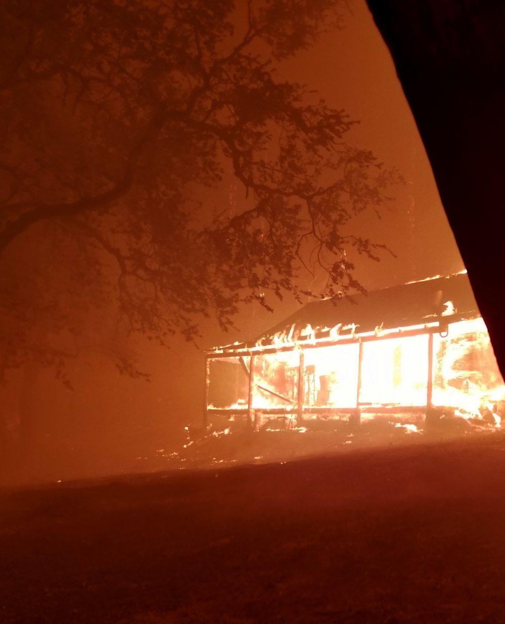 This Monday, Oct. 9, 2017, photo provided by Paul Hanssen shows his house burning in the Redwood Valley, Calif. Hanssen hid inside a portable trailer wrapped in water-soaked towels while the fast-moving wildfire tore through his mountain home.
