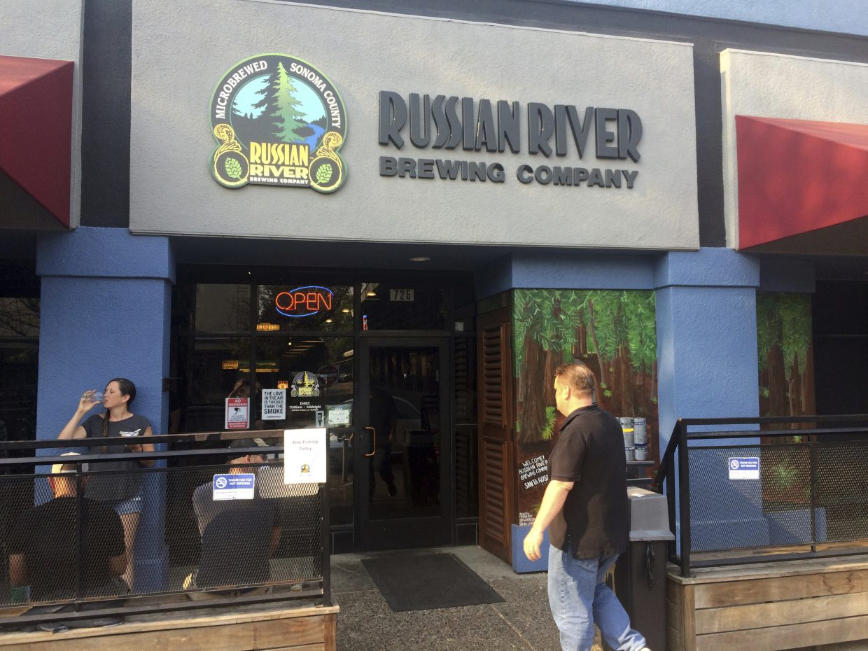The Russian River Brewery in Santa Rosa, Calif., has always been a gathering place for Santa Rosa residents and those who live nearby, as it is Friday, Oct. 13, 2017. Maker of the popular Pliny the Elder and Pliny the Younger beers, the brewery closed for just one day after wildfires ripped through the city's northern edge, part of a series of wind-whipped blazes north of San Francisco that quickly became the deadliest in state history.