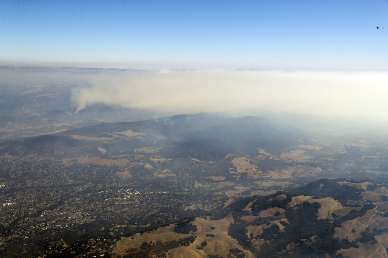 An aerial view shows a wildfire burning near Sonoma, Calif., on Saturday, Oct. 14, 2017.