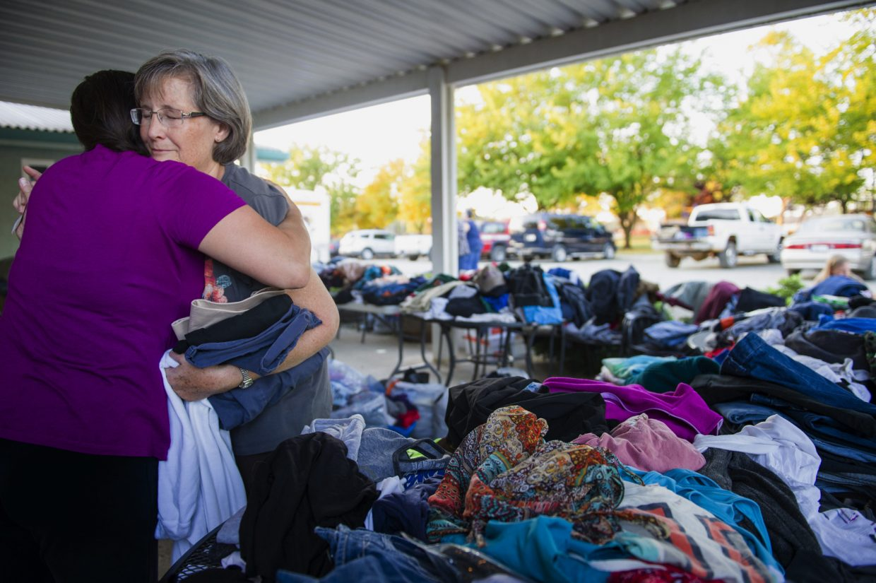 Donna Del Gadillo, left, of Sacramento, Calif., and Mary Carling, of Loma Rica, Calif., embrace while Carling looks for clothes at the Loma Rica Foothill Lions Club in Loma Rica on Sunday, Oct. 15, 2017. Carling's home was destroyed in a wildfire and Del Gadillo came to the club to volunteer.