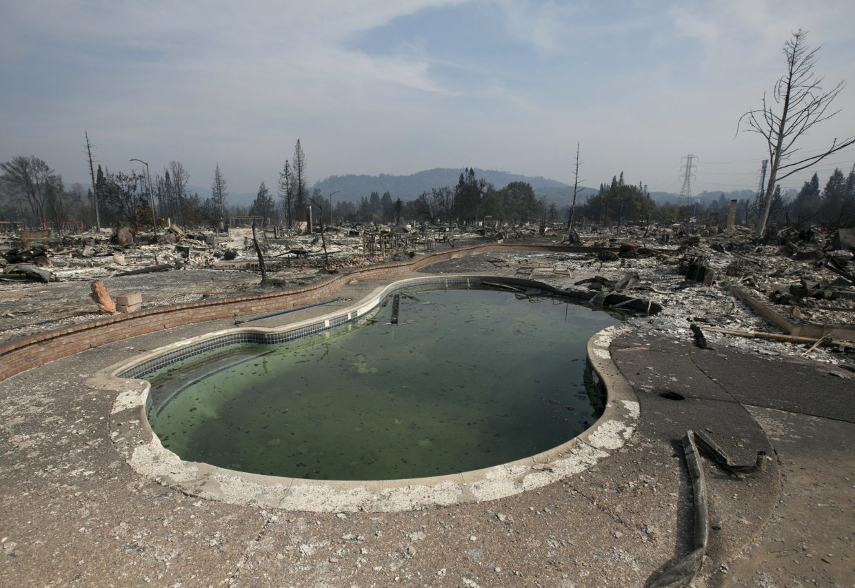 A swimming pool sits among the charred remains of a home in Santa Rosa, Calif., Monday, Oct. 16, 2017. Sonoma County Sheriff Rob Giordano said Monday there are reports of dozens of people missing in the county a week after deadly wildfires started in Northern California's wine country.
