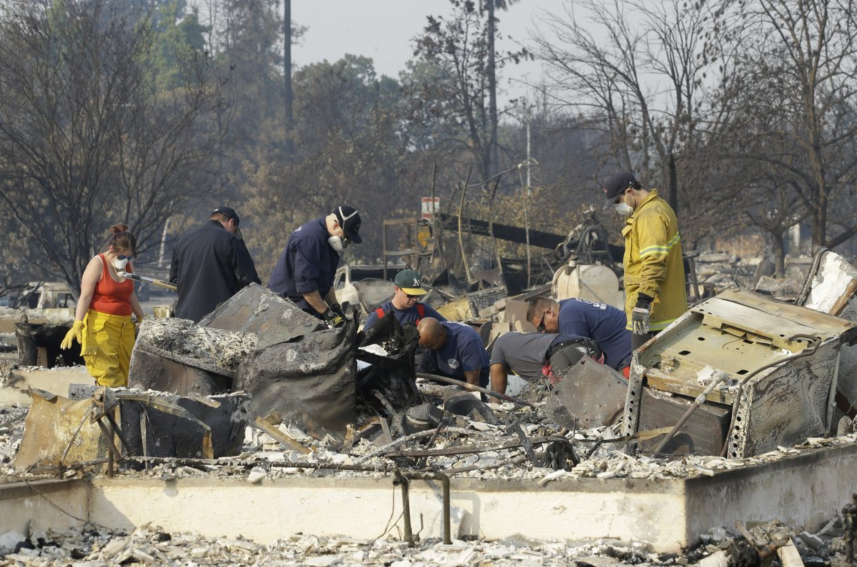Authorities sift through the burned area of a home as they search for victims at Coffey Park area of Santa Rosa, Calif., Monday, Oct. 16, 2017.