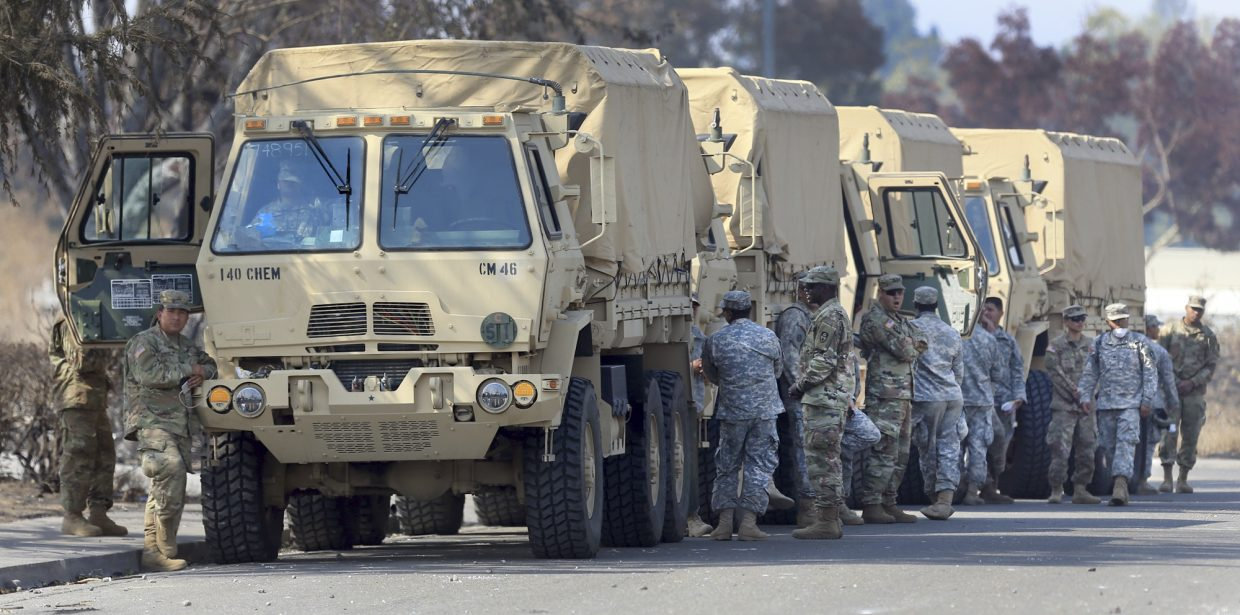 The National Guard deploys in to Larkfield, near Santa Rosa, Calif., Monday Oct. 16, 2017.