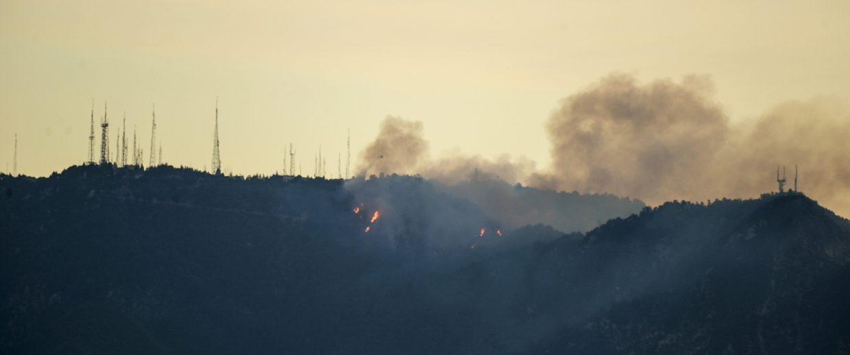 A fire burns near the summit of Mount Wilson early Tuesday, Oct. 17, 2017, northeast of Los Angles. Firefighters on the ground and in the air raced to protect the Mount Wilson Observatory and nearby communications towers from a growing brush fire.