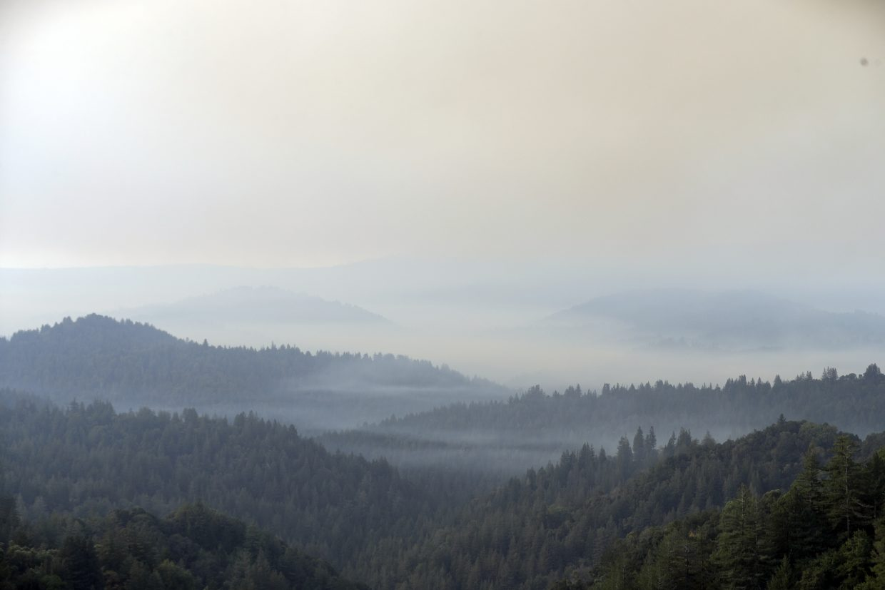 The Santa Cruz Mountains are covered in smoke from a wildfire Tuesday, Oct. 17, 2017, near Boulder Creek, Calif.