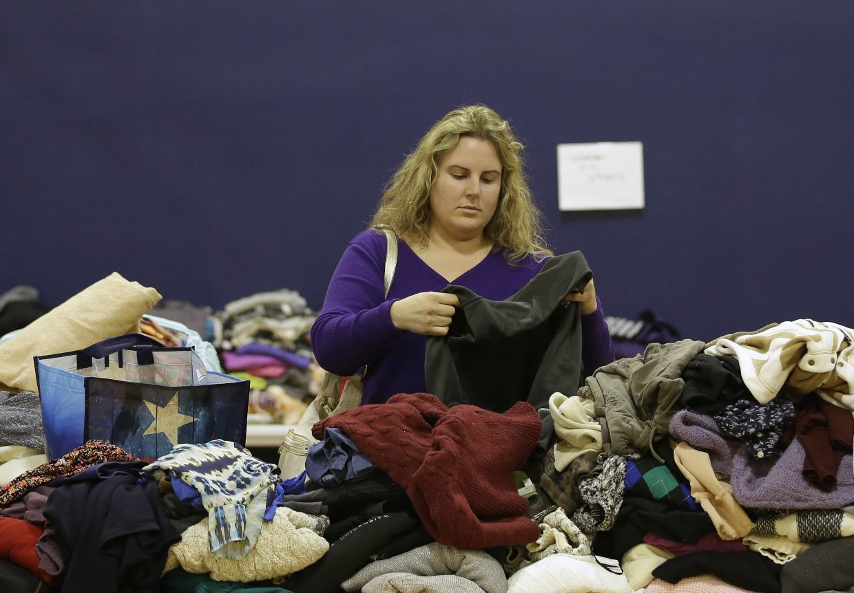 Jenna Latrache looks through clothes at a donation center for victims of the recent wildfires, Tuesday, Oct. 17, 2017, in Santa Rosa, Calif. Latrache lost her Coffey Park home when she and her family had to evacuate a week ago as a massive wildfire swept through the area.