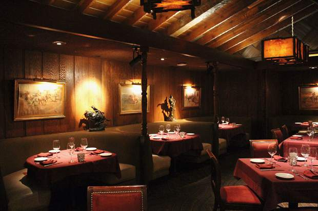 The Sage Room features old western paintings and hand-hewn beams from the original log cabin housing Harveys Wagon Wheel.