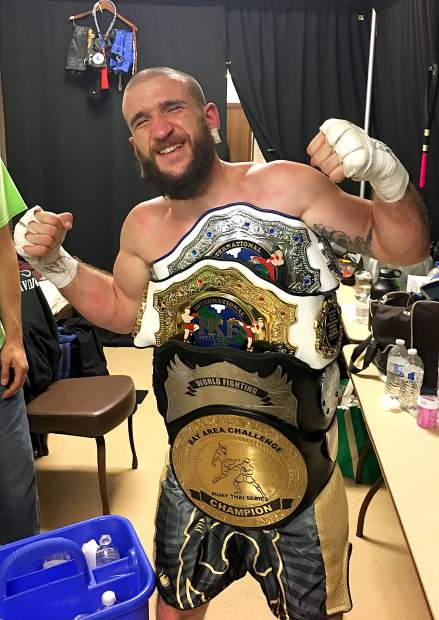 South Lake Tahoe's Cameron Church is all smiles Friday, Sept. 29, after winning his fourth amateur kickboxing championship belt.