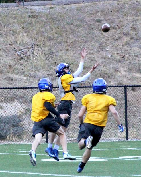 South Tahoe sophomore Drake Lathrop hauls in a long reception during Tuesday's practice.