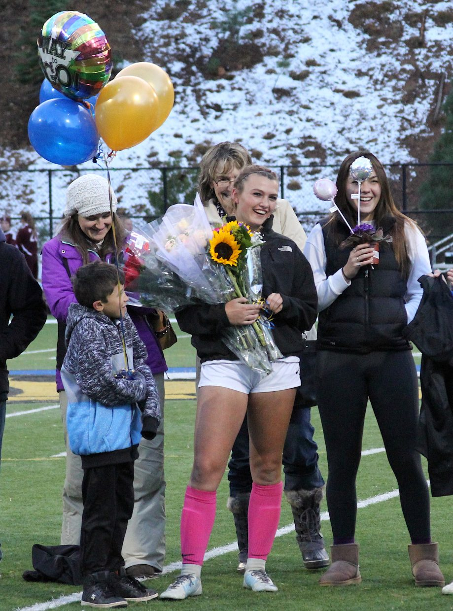 South Tahoe senior Samantha Frates stands with her family Friday at halftime.