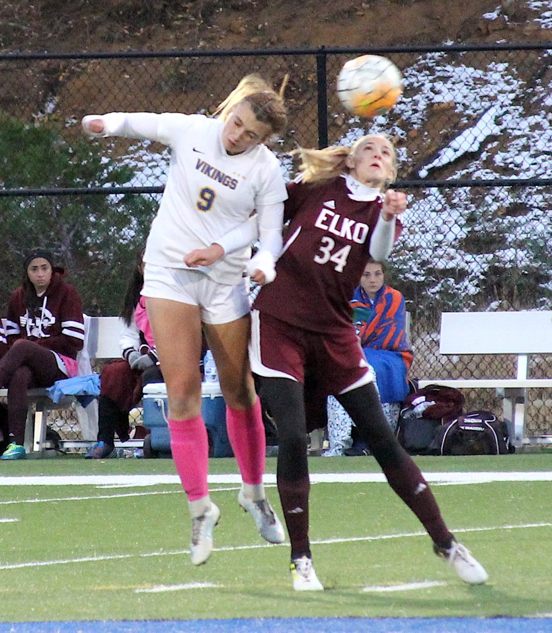 Vikings senior Samantha Frates heads the ball upfield Friday against Elko.
