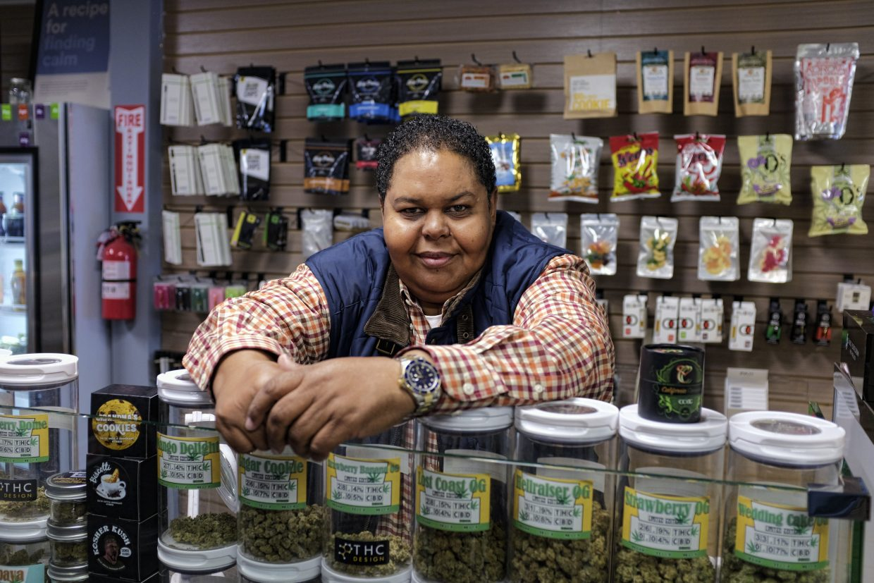 In this Friday, Nov. 3, 2017 photo Donnie Anderson, a Los Angeles medical cultivator, retailer and co-owner of Western Caregivers dispensary poses for at one of his dispensary's in Los Angeles. Anderson predicted the high level of state taxation next year is