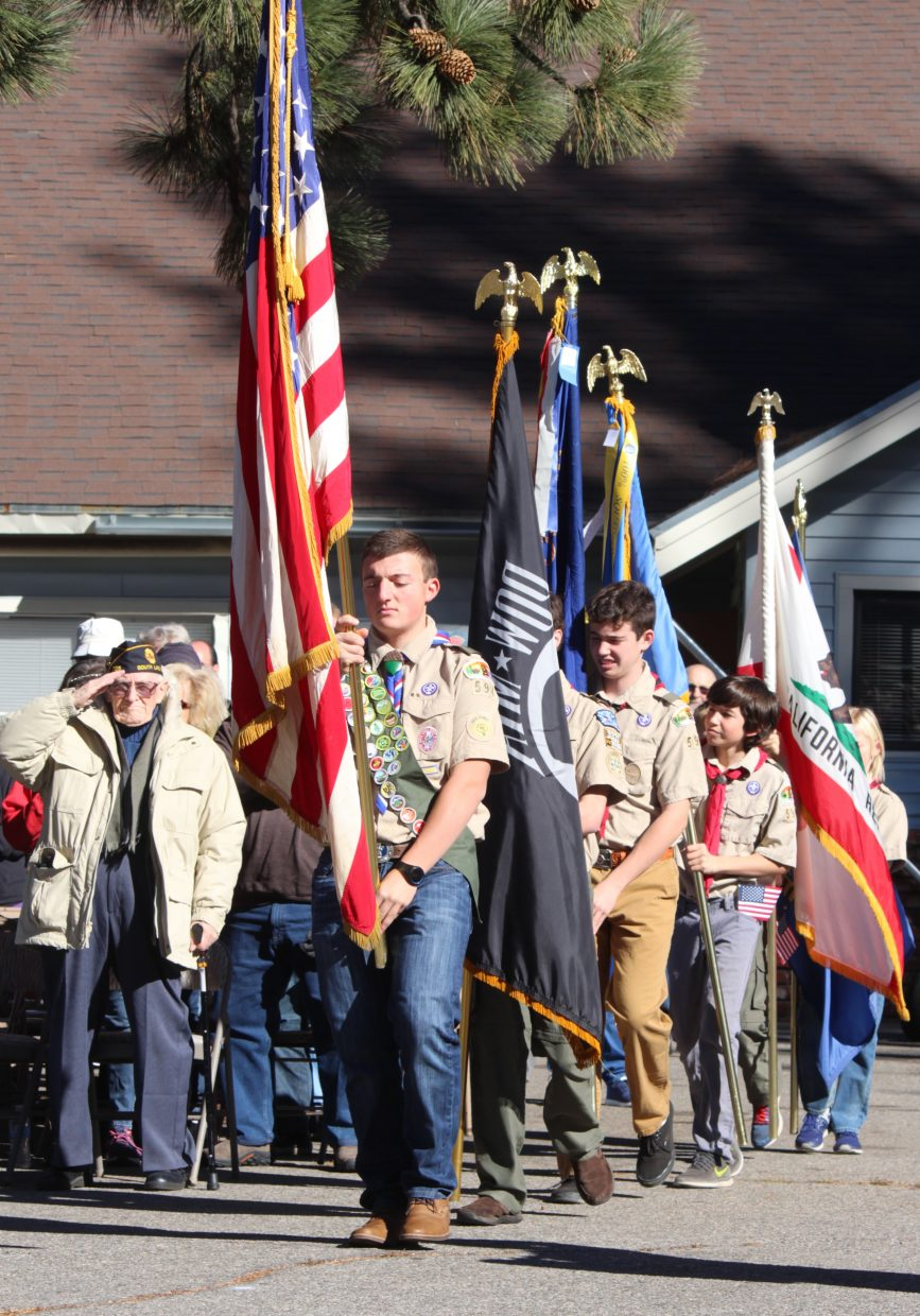 Members of South Lake Tahoe Boy Scout Troop 594 present the colors.