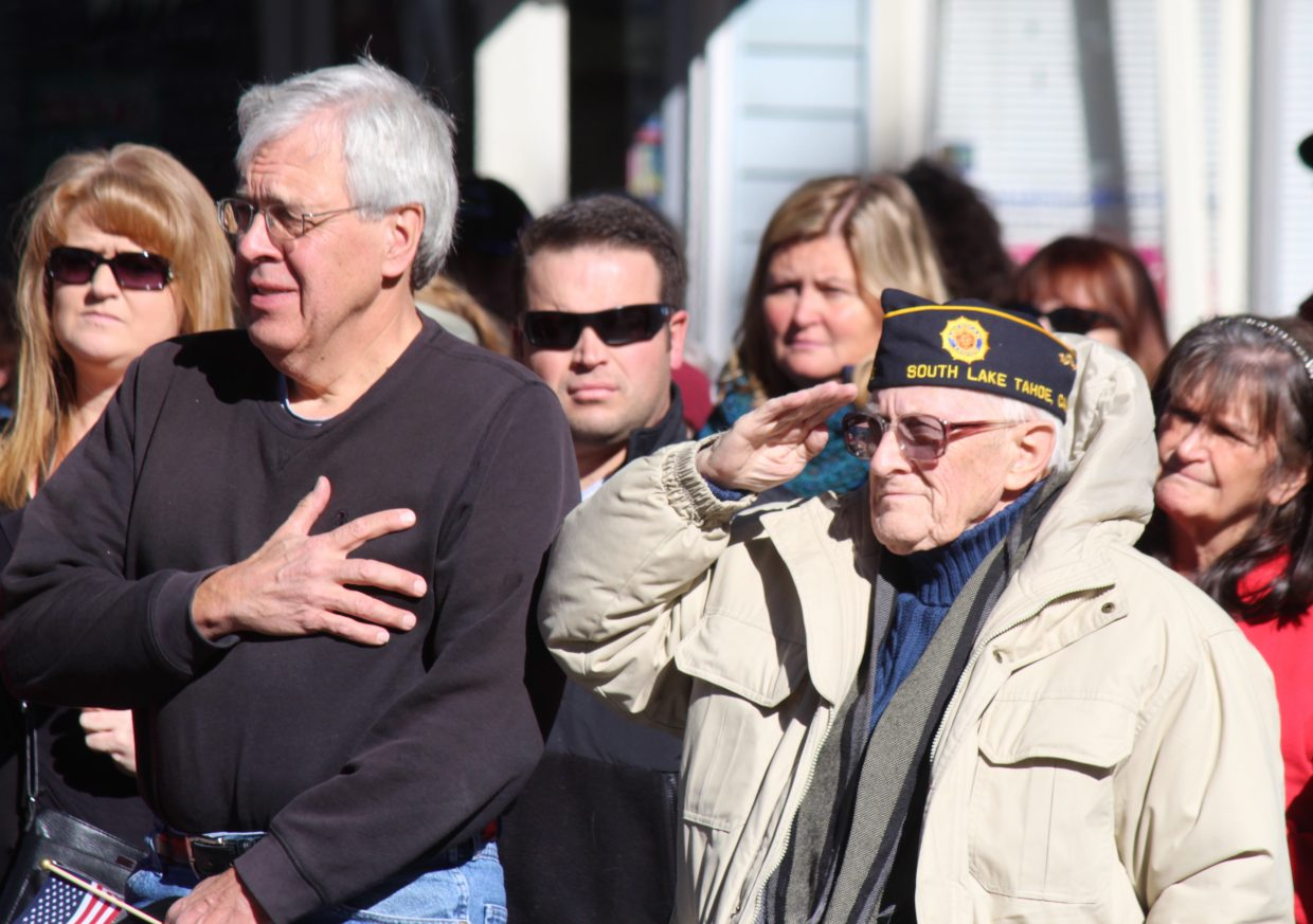 John Perry (right) stands at attention Saturday, Nov. 11. Perry is a WWII and Korean War veteran.