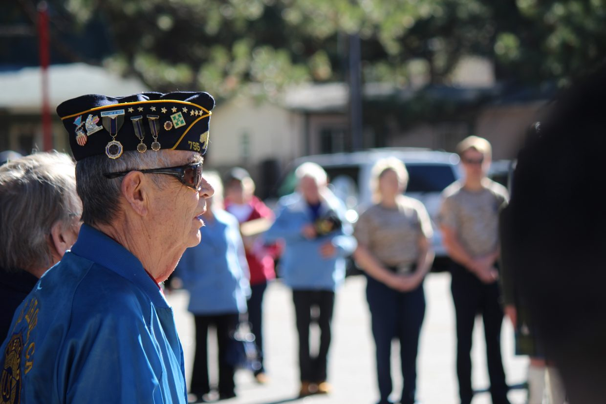 Veterans and members of the public pack the parking lot of American Legion Post 795.