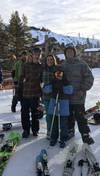Aaron Forrest (right) stands next to his kids Caylee, 15, Adam, 8, and his daughter's friend Carson Cavalli, 15, Wednesday, Nov. 22, at Kirkwood Mountain Resort. They arrived at 6 a.m. and were first in line.