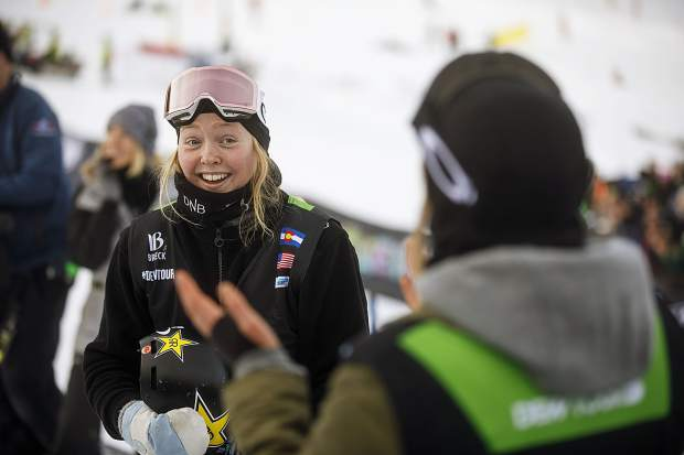 Johanne Killi of Norway interacts with colleagues following the slopestyle finals during the Dew Tour event Saturday, Dec. 16, at Breckenridge Ski Resort. Killi took home first with a high score of 90.