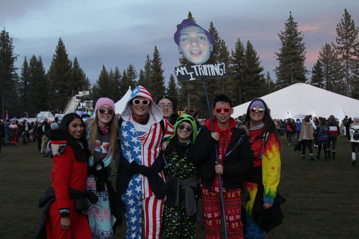SnowGlobe attendees showed off their homemade sign and costumes.