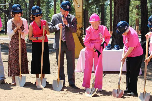Donning all pink, philanthropist Lisa Maloff breaks ground on Lake Tahoe Community College's new university center made possible by her $5.8 million donation.