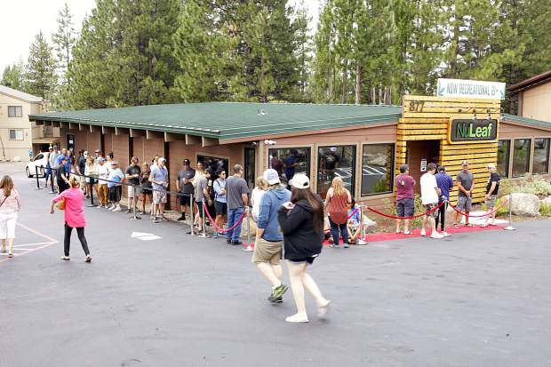 The line around NuLeaf stretched around the building before the store's recreational marijuana opening on Saturday, Aug. 5.
