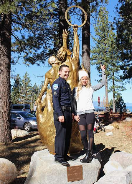 Olympic skier Travis Cabral and Olympic snowboarder Hannah Teter helped unveil the new statue at Champions Plaza.
