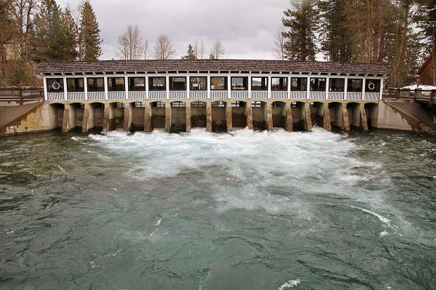 Water rushes through the Tahoe City Dam, pouring out of Lake Tahoe and into the Truckee River on April 6, 2017.