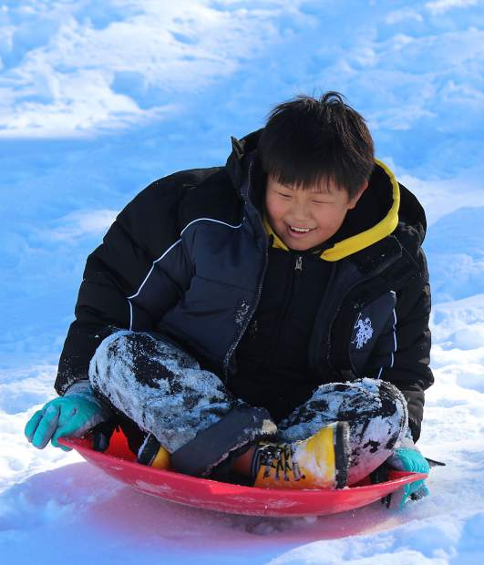 Forrest Li sleds down the hill at El Dorado Beach in South Lake Tahoe Thursday. A winter storm earlier in the week delivered plenty of snow for Forrest and his family, who are vacationing in South Lake Tahoe from San Francisco, and others to enjoy.