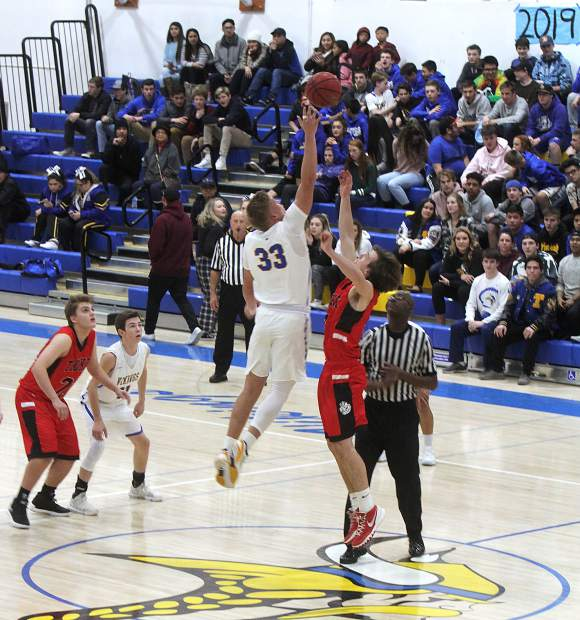 South Tahoe senior Mccallan Castles has no problem winning the opening tip Tuesday, Dec. 12, against Truckee.
