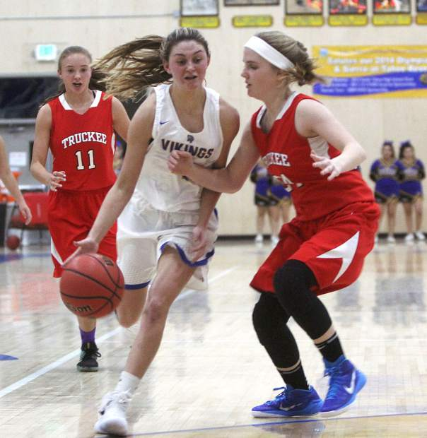 Viking Teagen Williamson drives into the lane Tuesday, Dec. 12, in against Truckee at South Tahoe High School.