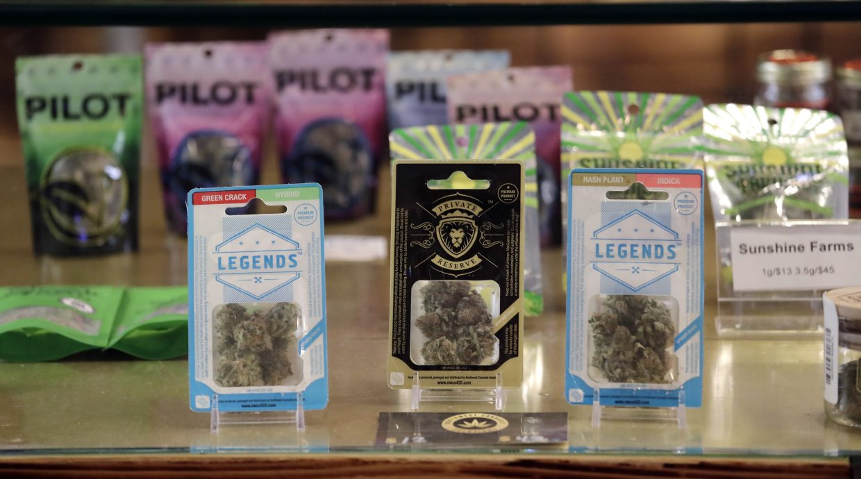 Marijuana products fill a display cabinet in the Herban Legends pot shop, Thursday, Jan. 4, 2018, in Seattle.