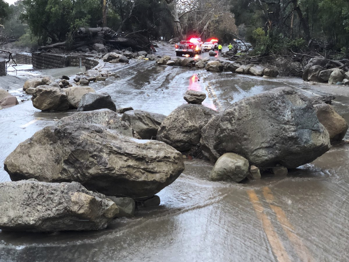 In this photo provided by Santa Barbara County Fire Department, mud and debris flow on the roadway due to heavy rain in Montecito. California, Tuesday, Jan. 9, 2018.