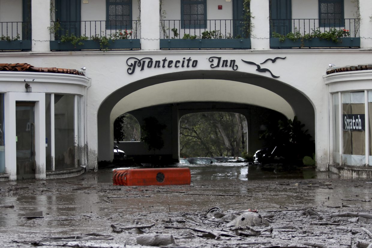 Debris and mud cover the entrance of the Montecito Inn after heavy rain brought flash flooding and mudslides to the area in Montecito, California, on Tuesday, Jan. 9, 2018.