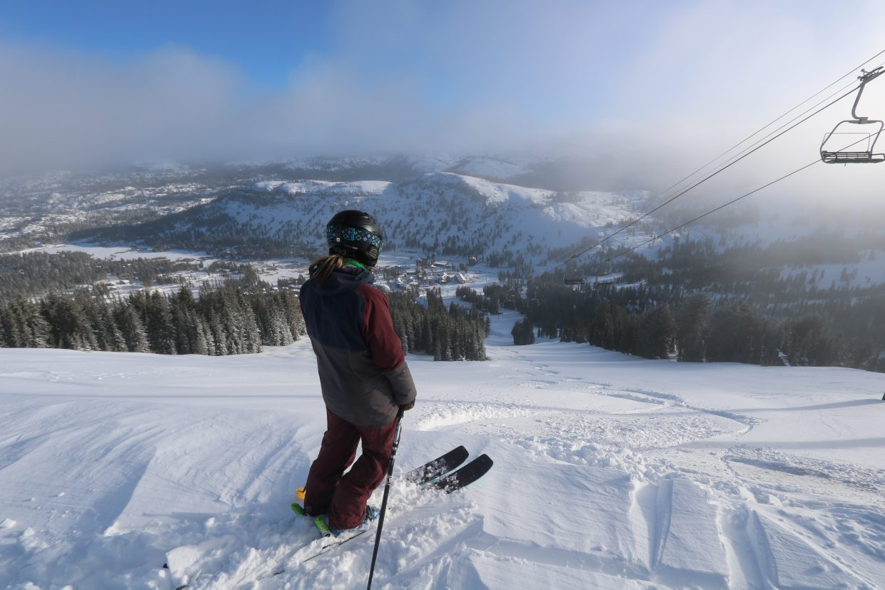 A skier takes in the view at Kirkwood Mountain Resort on Thursday, Jan. 25, a powder day in the Sierra.