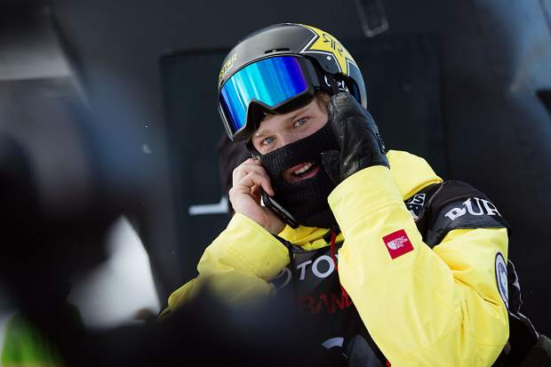 Kyle Mack smiles while speaking to his father on the other end of the phone after Mack won the Toyota U.S. Grand Prix at Mammoth Mountain and clinched a spot on the U.S. snowboard slopestyle and big air team for next month's Winter Olympics in Pyeongchang, South Korea.