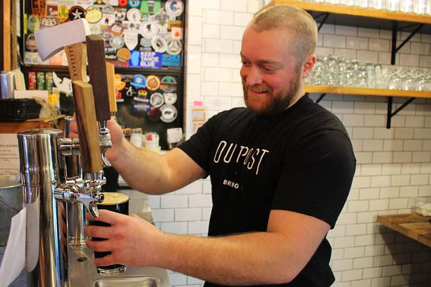 Kitchen manager Jimmy Davis pours a pint of Outpost's Horchata Stout.