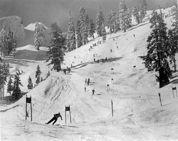 A skier bombs down the lower portion of the men's giant slalom course at Squaw Valley in 1960.