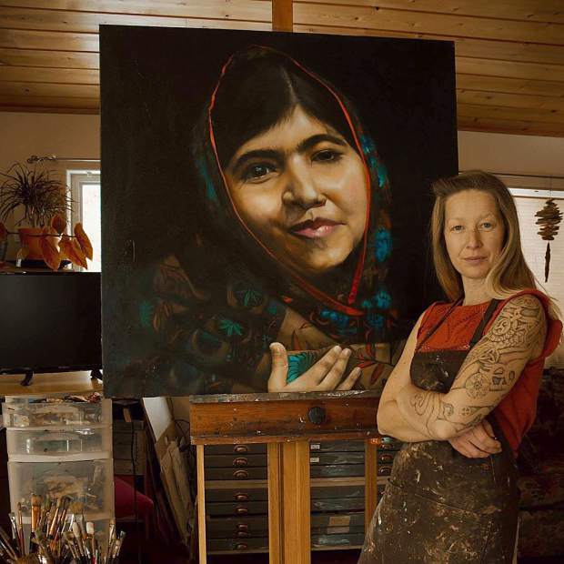 Shelley Zentner, founder of Tahoe Activist Artists, poses with her oil painting of Malala Yousafzai, the Nobel Prize-winning campaigner for Girls Rights to Education.