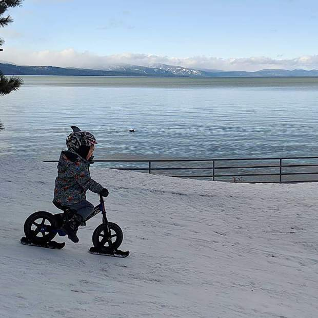 Bryce is loving the ski attachments for his strider bike!