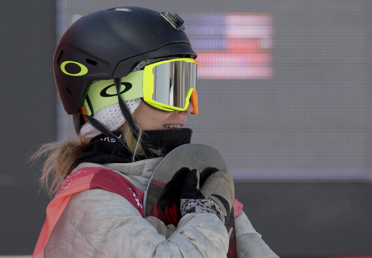 Jamie Anderson, of the United States, watches during the women's Big Air snowboard final at the 2018 Winter Olympics in Pyeongchang, South Korea, Thursday, Feb. 22, 2018.