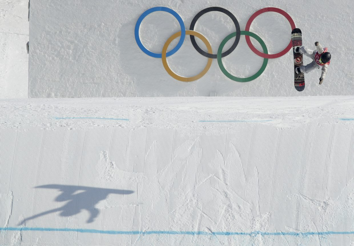 Jamie Anderson, of the United States, jumps during the women's Big Air snowboard final at the 2018 Winter Olympics in Pyeongchang, South Korea, Thursday, Feb. 22, 2018.