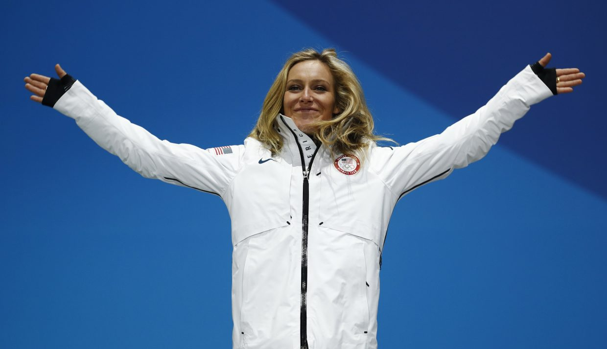 Silver medalist in the women's Big Air snowboard Jamie Anderson, of the United States, celebrates during the medals ceremony at the 2018 Winter Olympics in Pyeongchang, South Korea, Thursday, Feb. 22, 2018.