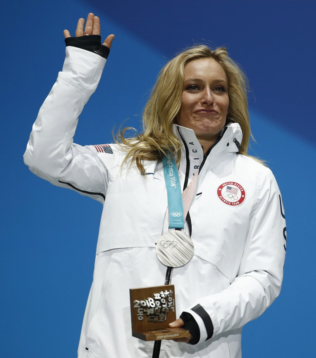 Silver medalist in the women's Big Air snowboard Jamie Anderson, of the United States, waves during the medals ceremony at the 2018 Winter Olympics in Pyeongchang, South Korea, Thursday, Feb. 22, 2018.
