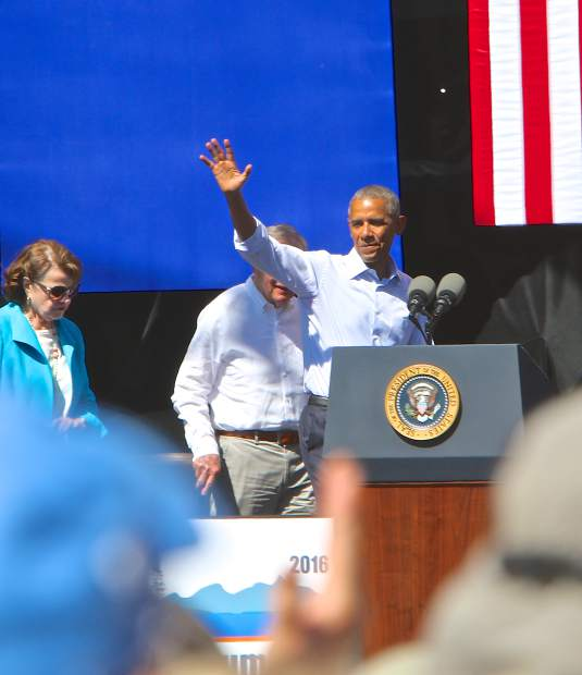 President Barack Obama waves to the crowd as he leaves Harvey's Outdoor Amphitheater Wednesday.